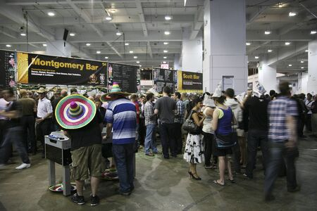 international beer: London, UK - August 05, 2010: Visitors of The Great British Beer Festival, 2010, at Earls Court, Britains biggest beer festival. Visitors can try wide range of real ales, ciders, perries and international beers.  Editorial