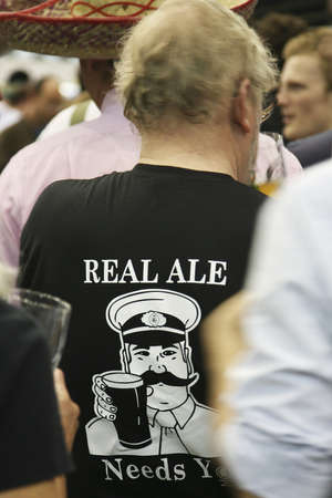 London, UK - August 05, 2010: Visitors of The Great British Beer Festival, 2010, at Earls Court, Britain's biggest beer festival. Visitors can try wide range of real ales, ciders, perries and international beers.  Stock Photo - 12445159