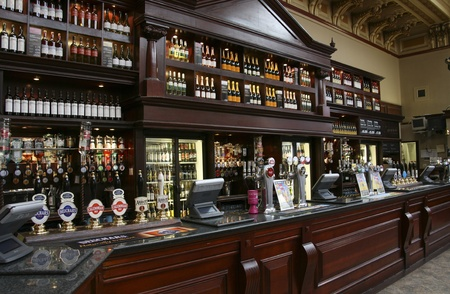 beer tap: Edinburgh, UK - July 24, 2010: Inside view of a public house, known as pub, for drinking and socializing, is the focal point of the community, Pub business, now about 53,500 pubs in the UK, has been declining every year.