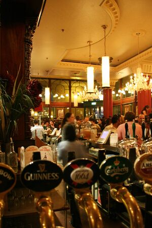 London, UK - June 03, 2006: Inside view of a public house, known as pub, for drinking and socializing, is the focal point of the community, Pub business, now about 53,500 pubs in the UK, has been declining every year.