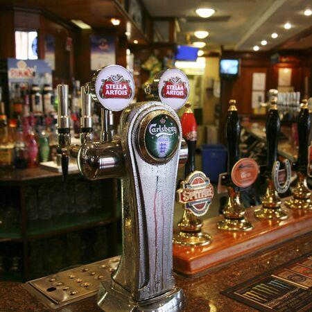 London, UK - August 26, 2010: Inside view of a public house, known as pub, for drinking and socializing, is the focal point of the community, Pub business, now about 53,500 pubs in the UK, has been declining every year.   Stock Photo - 12468937