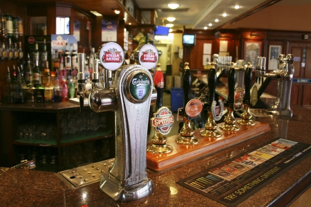 London, UK - August 26, 2010: Inside view of a public house, known as pub, for drinking and socializing, is the focal point of the community, Pub business, now about 53,500 pubs in the UK, has been declining every year.   Editorial