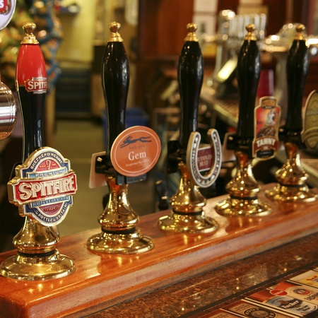 London, UK - August 26, 2010: Inside view of a public house, known as pub, for drinking and socializing, is the focal point of the community, Pub business, now about 53,500 pubs in the UK, has been declining every year.
