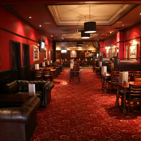british foods: London, UK - June 03, 2011: Inside view of a public house, known as pub, for drinking and socializing, is the focal point of the community, Pub business, now about 53,500 pubs in the UK, has been declining every year.