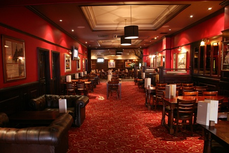 focal point: London, UK - June 03, 2011: Inside view of a public house, known as pub, for drinking and socializing, is the focal point of the community, Pub business, now about 53,500 pubs in the UK, has been declining every year.