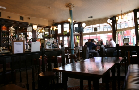 british foods: London, UK - August 03, 2010: Inside view of a public house, known as pub, for drinking and socializing, is the focal point of the community, Pub business, now about 53,500 pubs in the UK, has been declining every year.