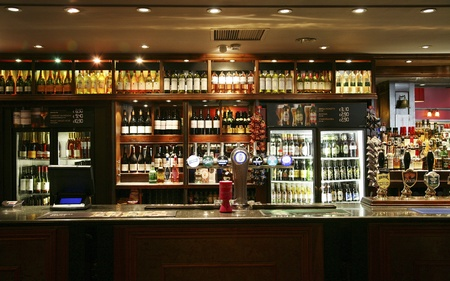pub: London, UK - June 03, 2011: Inside view of a public house, known as pub, for drinking and socializing, is the focal point of the community, Pub business, now about 53,500 pubs in the UK, has been declining every year.