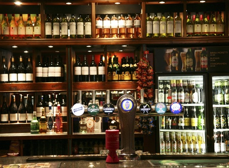 London, UK - June 03, 2011: Inside view of a public house, known as pub, for drinking and socializing, is the focal point of the community, Pub business, now about 53,500 pubs in the UK, has been declining every year.