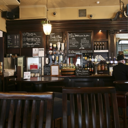 London, UK - August 03, 2010: Inside view of a public house, known as pub, for drinking and socializing, is the focal point of the community, Pub business, now about 53,500 pubs in the UK, has been declining every year.