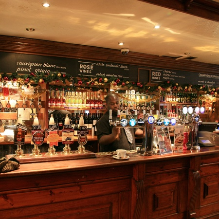 focal point: London, UK - December 01, 2010: Inside view of a public house, known as pub, for drinking and socializing, is the focal point of the community, Pub business, now about 53,500 pubs in the UK, has been declining every year.   Editorial