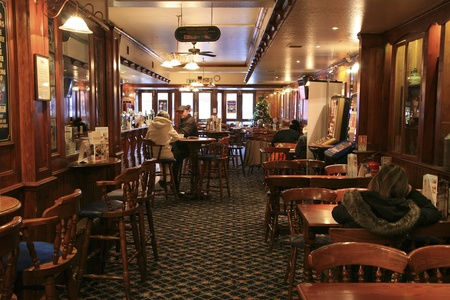 London, UK - December 01, 2010: Inside view of a public house, known as pub, for drinking and socializing, is the focal point of the community, Pub business, now about 53,500 pubs in the UK, has been declining every year.