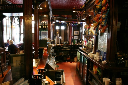 focal point: London, UK - August 30, 2010: Inside view of a public house, known as pub, for drinking and socializing, is the focal point of the community, Pub business, now about 53,500 pubs in the UK, has been declining every year.
