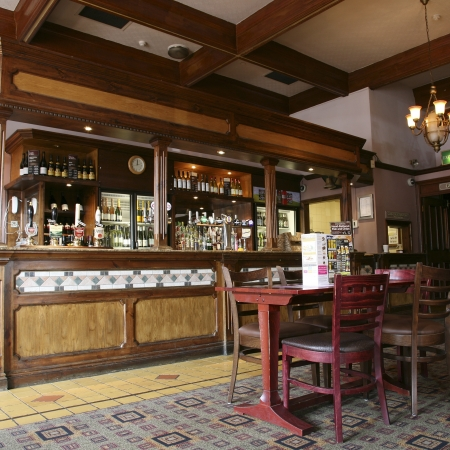London, UK - September 02, 2010: Inside view of a public house, known as pub, for drinking and socializing, is the focal point of the community, Pub business, now about 53,500 pubs in the UK, has been declining every year.   Editorial