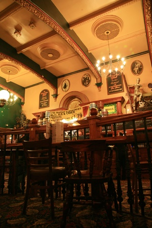 London, UK - October 28, 2010: Inside view of a public house, known as pub, for drinking and socializing, is the focal point of the community, Pub business, now about 53,500 pubs in the UK, has been declining every year.