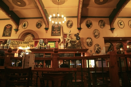 focal point: London, UK - October 28, 2010: Inside view of a public house, known as pub, for drinking and socializing, is the focal point of the community, Pub business, now about 53,500 pubs in the UK, has been declining every year.