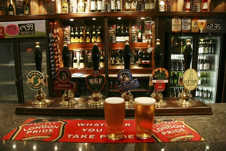 London, UK - September 06, 2010: Inside view of a public house, known as pub, for drinking and socializing, is the focal point of the community, Pub business, now about 53,500 pubs in the UK, has been declining every year.    Editorial