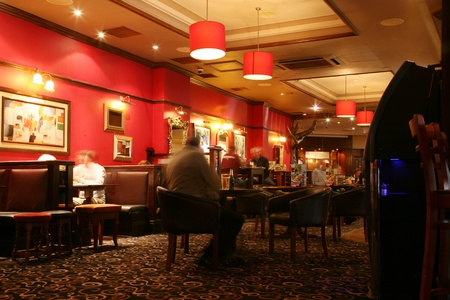 London, UK - September 06, 2010: Inside view of a public house, known as pub, for drinking and socializing, is the focal point of the community, Pub business, now about 53,500 pubs in the UK, has been declining every year.