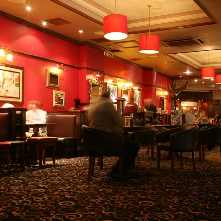 focal point: London, UK - September 06, 2010: Inside view of a public house, known as pub, for drinking and socializing, is the focal point of the community, Pub business, now about 53,500 pubs in the UK, has been declining every year.   Editorial