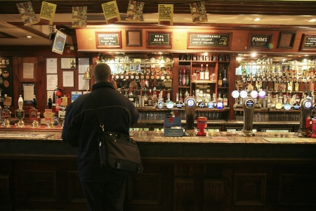 London, UK - November 04, 2010: Inside view of a public house, known as pub, for drinking and socializing, is the focal point of the community, Pub business, now about 53,500 pubs in the UK, has been declining every year.   Editorial