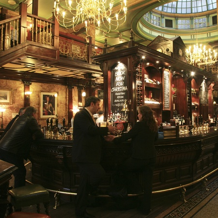 bar interior: London, UK - November 04, 2010: Inside view of a public house, known as pub, for drinking and socializing, is the focal point of the community, Pub business, now about 53,500 pubs in the UK, has been declining every year.   Editorial