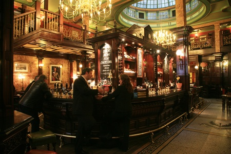 beer tap: London, UK - November 04, 2010: Inside view of a public house, known as pub, for drinking and socializing, is the focal point of the community, Pub business, now about 53,500 pubs in the UK, has been declining every year.   Editorial