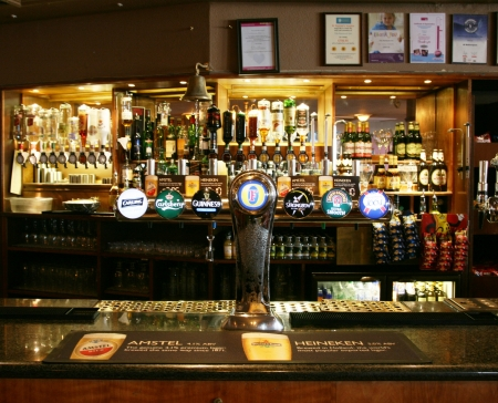 London, UK - March 07, 2011: Inside view of a public house, known as pub, for drinking and socializing, is the focal point of the community, Pub business, now about 53,500 pubs in the UK, has been declining every year.   Editorial
