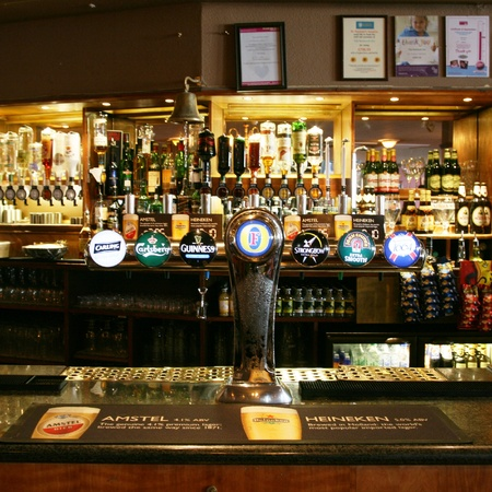 London, UK - March 07, 2011: Inside view of a public house, known as pub, for drinking and socializing, is the focal point of the community, Pub business, now about 53,500 pubs in the UK, has been declining every year.