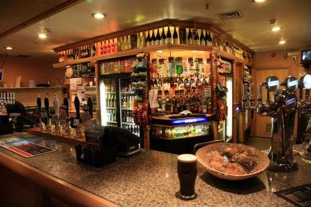London, UK - September 17, 2010: Inside view of a public house, known as pub, for drinking and socializing, is the focal point of the community, Pub business, now about 53,500 pubs in the UK, has been declining every year.   Stock Photo - 12468967
