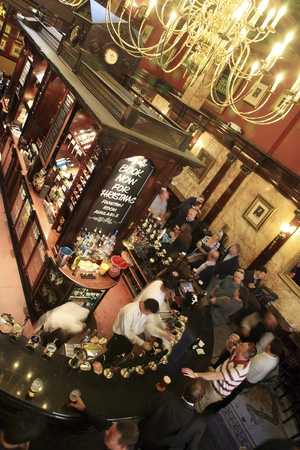London, UK - September 17, 2010: Inside view of a public house, known as pub, for drinking and socializing, is the focal point of the community, Pub business, now about 53,500 pubs in the UK, has been declining every year.