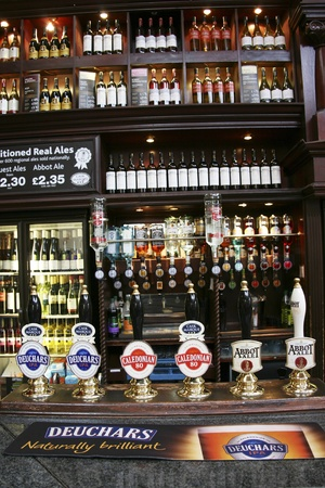 London, UK - July 23, 2010: Inside view of a public house, known as pub, for drinking and socializing, is the focal point of the community, Pub business, now about 53,500 pubs in the UK, has been declining every year.