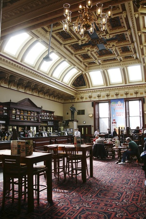 Edinburgh, UK - July 23, 2010: Inside view of a public house, known as pub, for drinking and socializing, is the focal point of the community, Pub business, now about 53,500 pubs in the UK, has been declining every year.