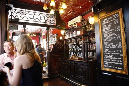 London, UK - June 26, 2011: Inside view of a public house, known as pub, for drinking and socializing, is the focal point of the community, Pub business, now about 53,500 pubs in the UK, has been declining every year.