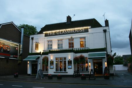 London, UK - July 26, 2010: Outside view of a public house, known as pub, for drinking and socializing, is the focal point of the community, Pub business, now about 53,500 pubs in the UK, has been declining every year.    Stock Photo - 12513225