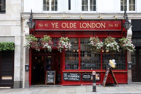 London, UK - September 14, 2010: Outside view of a public house, known as pub, for drinking and socializing, is the focal point of the community, Pub business, now about 53,500 pubs in the UK, has been declining every year.