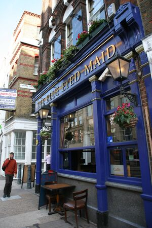London, UK - August 17, 2010: Outside view of a public house, known as pub, for drinking and socializing, is the focal point of the community, Pub business, now about 53,500 pubs in the UK, has been declining every year.  Stock Photo - 12513259