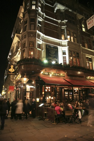 London, UK - November 06, 2010: Outside view of a public house, known as pub, for drinking and socializing, is the focal point of the community, Pub business, now about 53,500 pubs in the UK, has been declining every year.    Stock Photo - 12512786