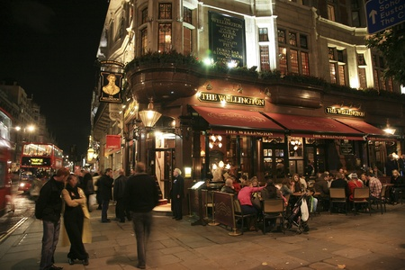 british foods: London, UK - November 06, 2010: Outside view of a public house, known as pub, for drinking and socializing, is the focal point of the community, Pub business, now about 53,500 pubs in the UK, has been declining every year.
