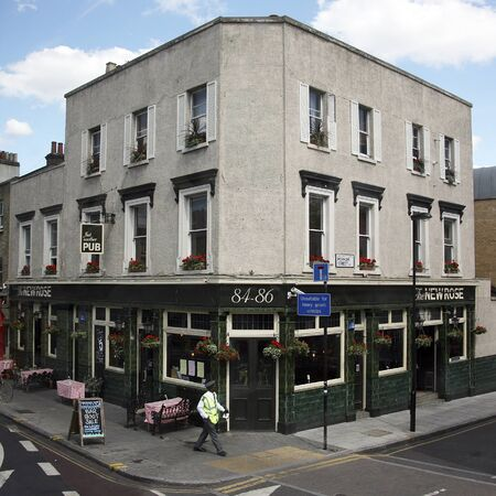 London, UK - July 21, 2010: Outside view of a public house, known as pub, for drinking and socializing, is the focal point of the community, Pub business, now about 53,500 pubs in the UK, has been declining every year.    Stock Photo - 12513244