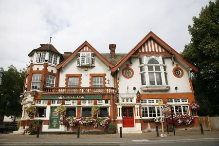 London, UK - August 14, 2011: Outside view of a public house, known as pub, for drinking and socializing, is the focal point of the community, Pub business, now about 53,500 pubs in the UK, has been declining every year.