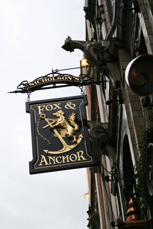 London, UK - April 09, 2006: English pub sign. Public house, known as pub, for drinking and socializing, is the focal point of the community. Pub business, now about 53,500 pubs in the UK, has been declining every year.   Stock Photo - 12641884