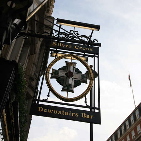 London, UK - October 18, 2010: English pub sign. Public house, known as pub, for drinking and socializing, is the focal point of the community. Pub business, now about 53,500 pubs in the UK, has been declining every year.  Stock Photo - 12641888