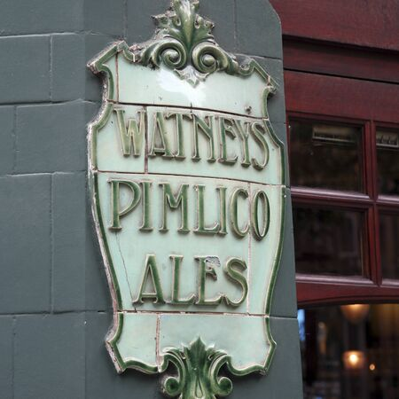 London, UK - August 16, 2010: English pub sign. Public house, known as pub, for drinking and socializing, is the focal point of the community. Pub business, now about 53,500 pubs in the UK, has been declining every year.  Stock Photo - 12641891