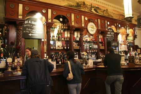 focal point: London, UK - June 3, 2006: Inside view of a public house, known as pub, for drinking and socializing, is the focal point of the community, Pub business, now about 53,500 pubs in the UK, has been declining every year. Editorial