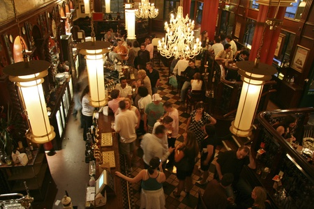 London, UK - June 3, 2006: Inside view of a public house, known as pub, for drinking and socializing, is the focal point of the community, Pub business, now about 53,500 pubs in the UK, has been declining every year.