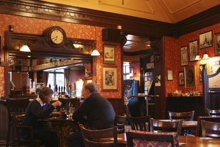 London, UK - April 30, 2006: Inside view of a public house, known as pub, for drinking and socializing, is the focal point of the community, Pub business, now about 53,500 pubs in the UK, has been declining every year.