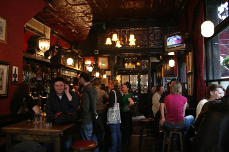 London, UK - May 7, 2006: Inside view of a public house, known as pub, for drinking and socializing, is the focal point of the community, Pub business, now about 53,500 pubs in the UK, has been declining every year.