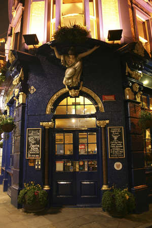 London, UK - April 13, 2006: Outside view of a public house, known as pub, for drinking and socializing, is the focal point of the community, Pub business, now about 53,500 pubs in the UK, has been declining every year.  Stock Photo - 12716851