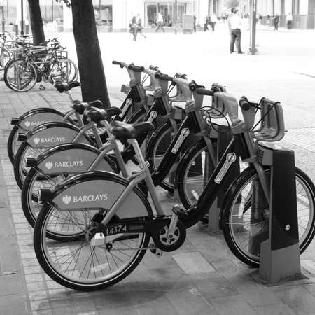 at ease: London, UK - August 20, 2010 : Londons bicycle sharing scheme, to help ease traffic congestion, sponsored by Barclays, was launched on 30 July 2010. Currently there are some 6,000 bikes and 400 docking stations in London.    Editorial