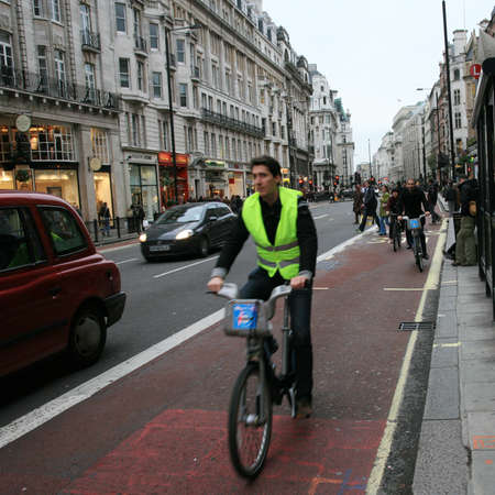boris: London, UK - November 13, 2010 : Commuters on rental bike. Londons bicycle sharing scheme, to help ease traffic congestion, sponsored by Barclays, was launched on 30 July 2010. Currently there are some 6,000 bikes and 400 docking stations in London.     Editorial