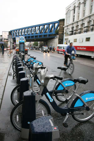 at ease: London, UK - August 25, 2010 : Londons bicycle sharing scheme, to help ease traffic congestion, sponsored by Barclays, was launched on 30 July 2010. Currently there are some 6,000 bikes and 400 docking stations in London.    Editorial